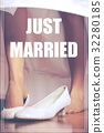Word Just Married over shoe of the bride 32280185