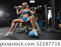 fitness girl exercising with barbell in gym 32287716