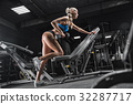 fitness girl exercising with barbell in gym 32287717