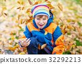 happy cute little kid boy with autumn leaves 32292213