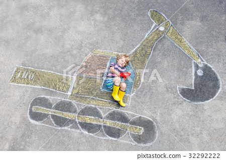 Funny little kid boy with excavator chalk picture 32292222