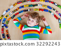 Cute little blond kid boy playing with lots of toy 32292243