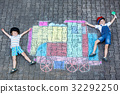 Two little kids boys having fun with train chalks 32292250
