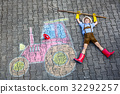 little kid boy having fun with tractor chalks 32292257