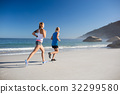 Friends jogging at the beach 32299580