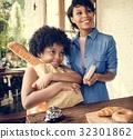 Customer buying bread at bake shop 32301862