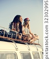 Hipster People Sitting on The Roof of The Van Road Trip Travel 32302995