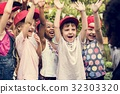 Group of Diverse Kids Hands Raising Up Cheerfully Together 32303320