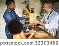 Customer Buying Fresh Baked Bread in Bakery Shop 32303469