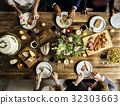 Bride and Groom Having Meal with Friends at Wedding Reception 32303663