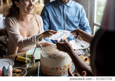 People celebrate birthday party with cake and card 32303750