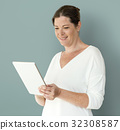 Adult Woman Using Digital Tablet Studio 32308587