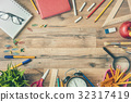 Wooden desk with supplies 32317419