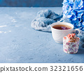 Cup of tea on blue background with flowers 32321656