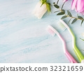 Two pastel toothbrushes with flowers herbs 32321659