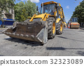 Heavy bulldozer, roller during road construction. 32323089