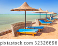 Relax under parasol on the beach of Red Sea, Egypt 32326696