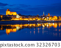 Torun at night reflected in the river, Poland 32326703