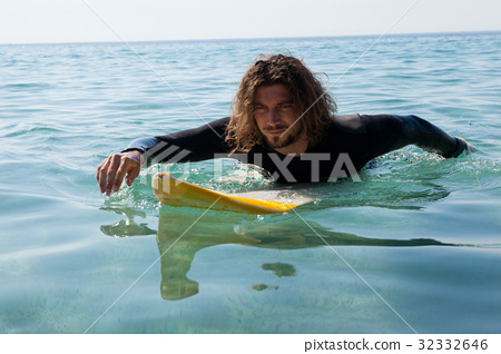 Surfer surfing in the sea 32332646