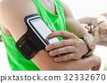 Man using mobile phone on beach 32332670