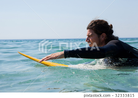 Surfer surfboarding in the sea 32333815