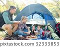 Family having snacks outside the tent 32333853