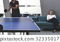 People break playing table tennis relax 32335017