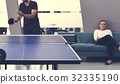 People break playing table tennis relax 32335190