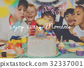 Group of diverse children blowing birthday cake together 32337001