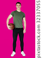 Young adult muscular man holding basketball 32337055