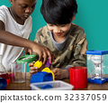 Students studying scientific experiment research 32337059