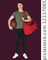 Young adult muscular man holding basketball 32337065