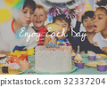 Group of diverse children blowing birthday cake together 32337204
