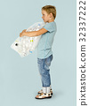 Ecology little boy holding bag of plastic bottle for recycle 32337222