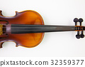 Old violin on the white table 32359377