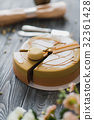 Bakery with piece of unusual yellow mousse cake 32361428
