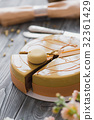 Bakery with piece of unusual yellow mousse cake 32361429