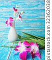 Pink orchid with vase on blue background 32362038
