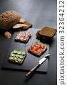 Sandwich with cereals bread smoked salmon beetroot and cucumber on dark marble background 32364212