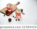 Strawberry juice cocktail with ice and mint on white tone amd wooden 32364420