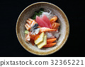 Sushi don , raw salmon tuna octopus and egg on rice 32365221