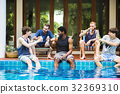 Group of diverse men sitting by the pool 32369310
