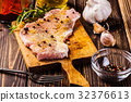 Raw pork slices prepared for roast with spices 32376613