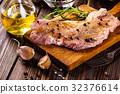 Raw pork slices prepared for roast with spices 32376614