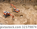 Excavators at sandpit during earthmoving works 32379874