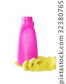 Hand in rubber yellow glove holds pink bottle of 32380765