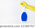 Hand in yellow glove holds spray  bottle of liqui 32380767