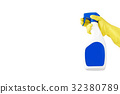 Hand in rubber yellow glove holds  spray bottle o 32380789
