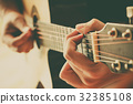 hand play guitar 32385108