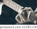 hand play guitar 32385138